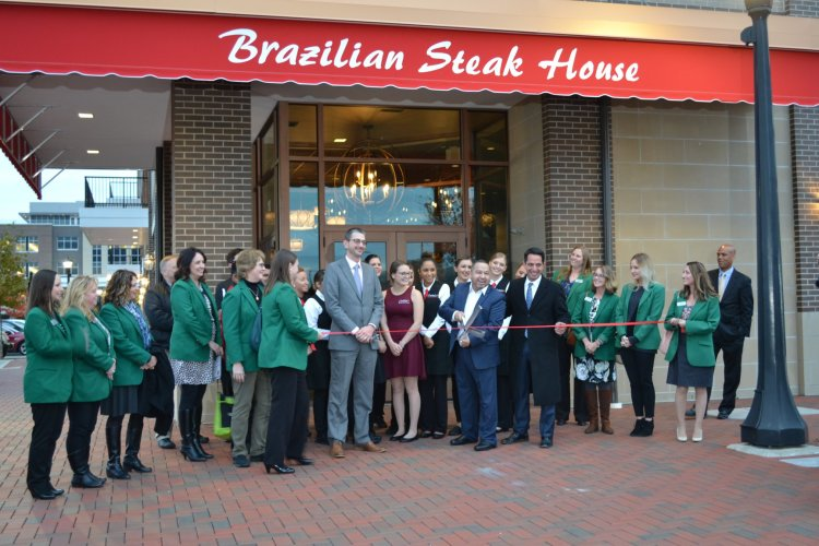 Chamber members gather for a ribbon cutting at Costela Brazilian Steakhouse
