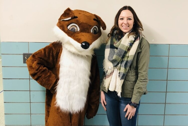 Cierra Hessbrook, from Bay Area Women's Center, poses with Felix the Friendly Fox. Felix is the center's body safety mascot who helps educate students about consent and boundaries.