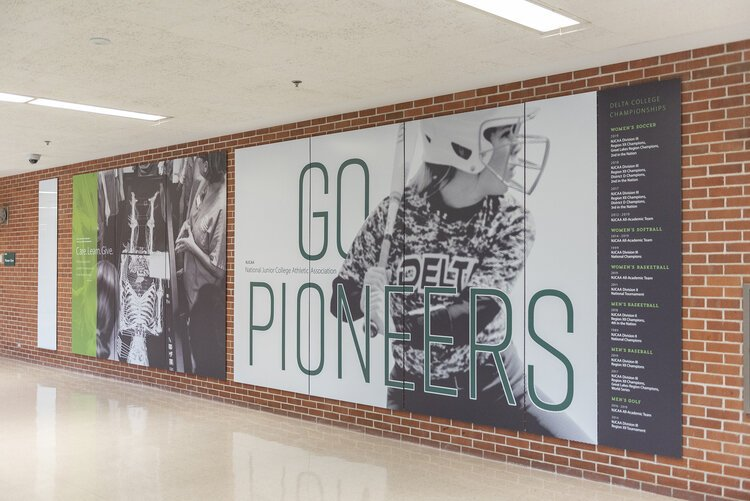 Public art and graphics proudly displayed on the walls of Delta College are part of an effort to help students and visitors feel a connection to the institution.