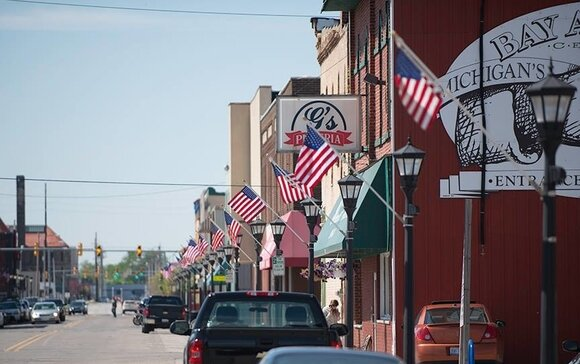 Since 2010, local business owner Avram Golden has been raising money to line Bay City's streets with American flags in tribute to those who served in the military.