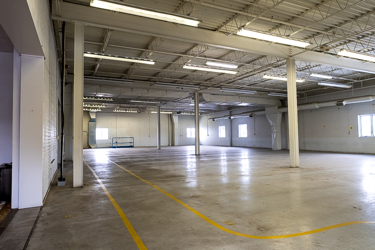 The warehouse interior has served as the destination for Hell's Half Mile music events, working spaces for local nonprofits, and 30,000 square feet of storage space for car fanatics' summer rides