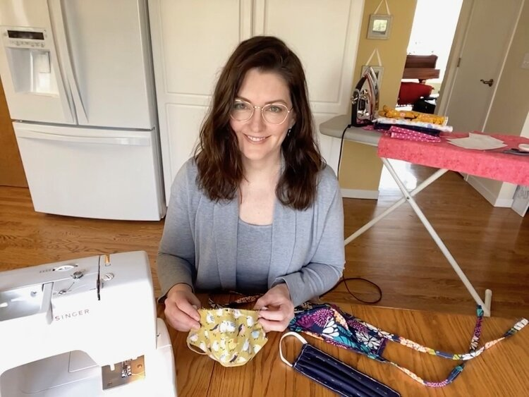 Dana Schramm, a Costume Goddesses volunteer is hard at work making face masks for those in need.