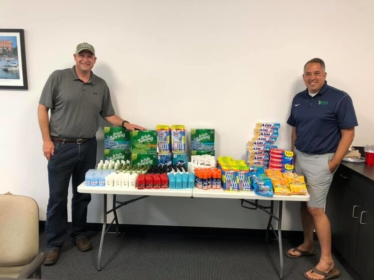 Rob Clark and Matt Felan with the donations provided by Michigan Sugar Company.