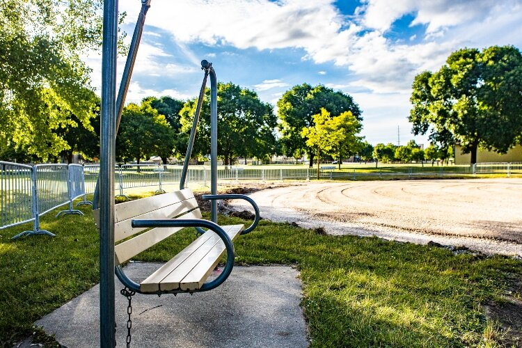 Bench swings still sit near Play City, giving parents and others a place to rest and watch the kids have fun.