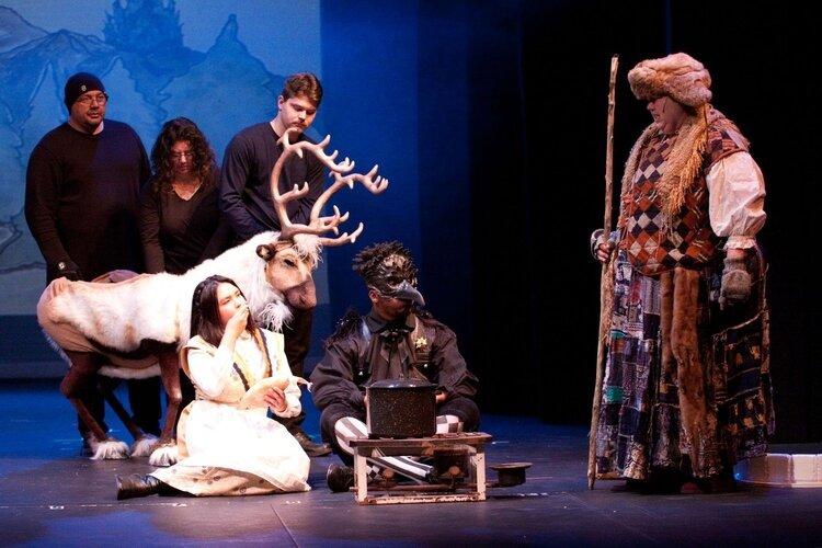 Three people work together to operate the reindeer puppet appearing onstage at the Bay City Players this weekend.