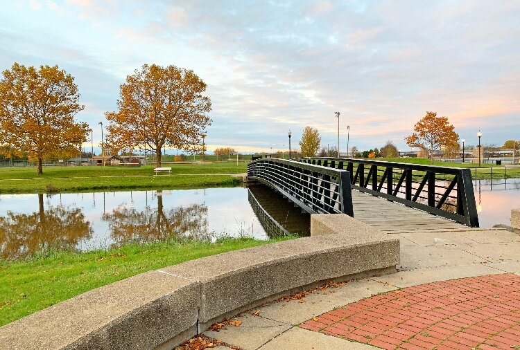 A bridge on the Bay City Riverwalk connects Veterans Memorial Park to the Kantzler Memorial Arboretum.