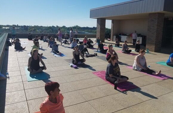 The RAC, an athleisure clothing boutique that opened in Uptown Bay City last fall, is hosting rooftop yoga on July 20.