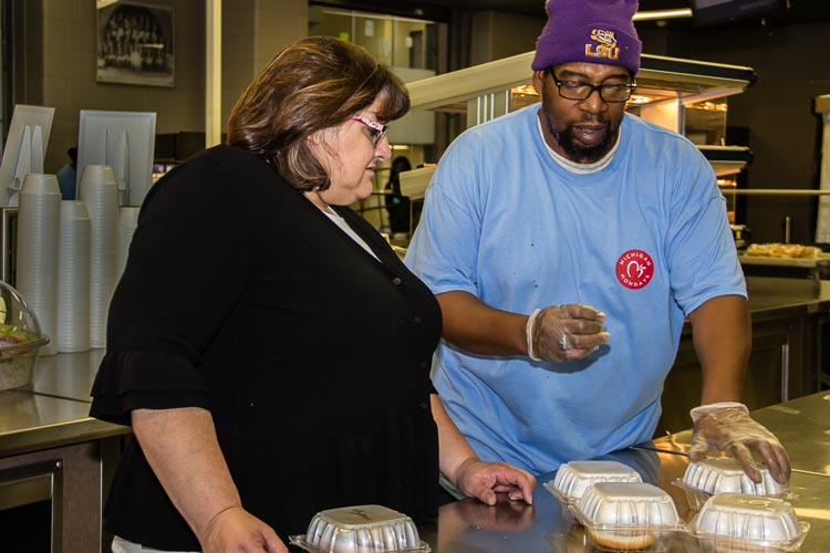 Michelle Morrissey, dining services director for Battle Creek Public Schools, works with Mo Robinson to provide healthy foods for students.