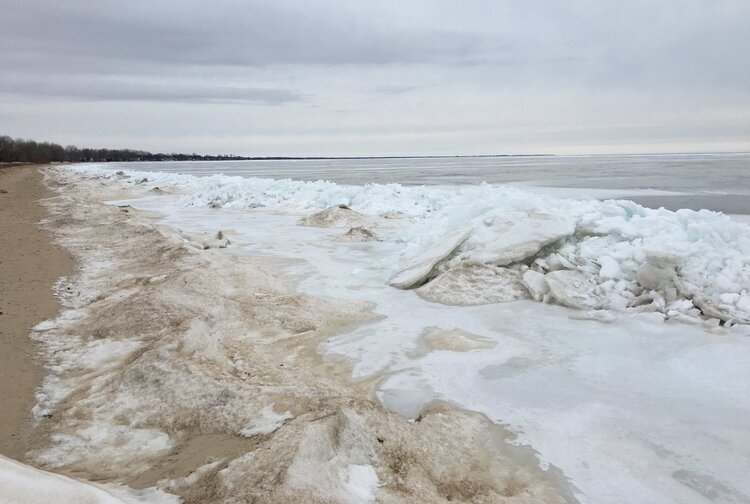 Sand and ice swirl together along the edges of the Saginaw Bay in the winter, creating a unique landscape at the Bay City State Park. The park offers winter activities for families including a special Feb. 15 event.
