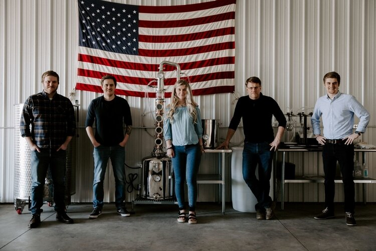 The Lange family – from left, Kenneth (Ken), Kameron, Khloe, David, and Konnor Lange – opened Third Wind Distilling in Bay City. Ken, Kameron, Khloe, and Konnor are siblings. David is their father.