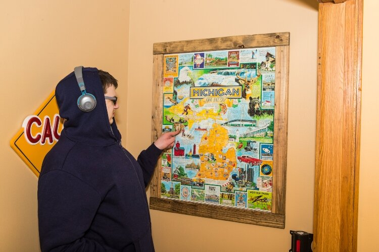 Tristan Dean was once a patient at Game Changer Pediatric Therapy Services. Today, the 19-year-old is an employee, working as the assistant to the property manager. One of his first duties was to build a wooden frame so this puzzle could be displayed