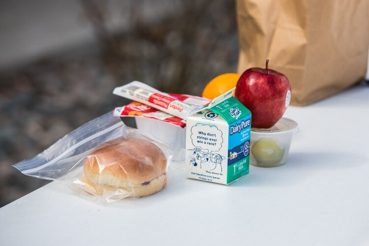 The Dow Bay Area Family Y distributes wholesome, nourishing breakfasts, lunches, and dinners.