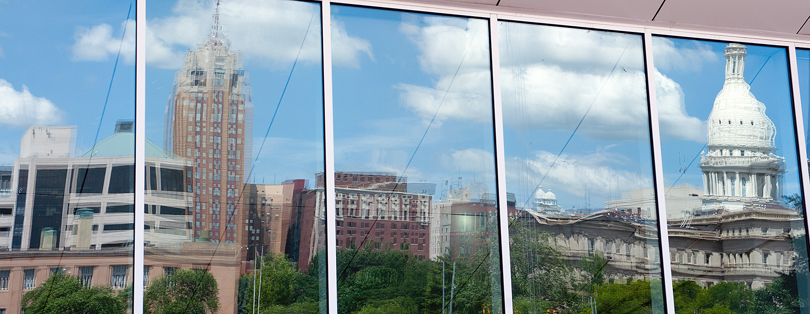 The Lansing skyline reflected in the glass of Constitution Hall - Photo Dave Trumpie