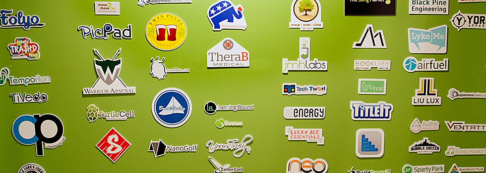 Dozens of logos of companies started there adorn the walls of the HATCH in East Lansing � Photo Dave