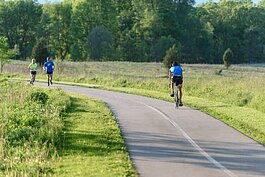 Bikers and runners take a trip on the B2B Trail.