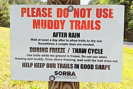 A sign warning cyclists to stay off the trail during the spring thaw.