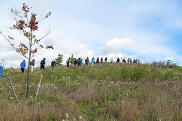 A group on a guided hike at LeFurge Woods Nature Preserve (pre-pandemic).  Photo by Scott Tyrrell.