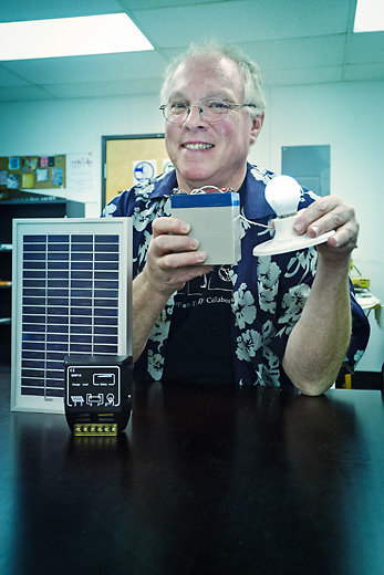 John Barrie with his solar lighting system