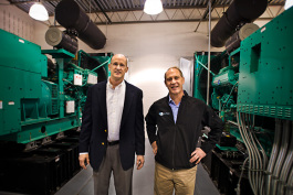L to R Mike Klein and Yan Ness with the twin power generators at Online Tech in Ann Arbor