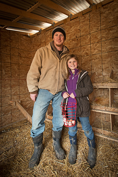 Jason Gold and his daughter gathering eggs at the Michigan Folk School