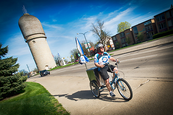 Rob Hess riding home past the Water Tower