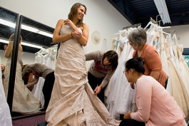 Kristen Oltersdorf trying on a wedding dress at The Brides Project Boutique