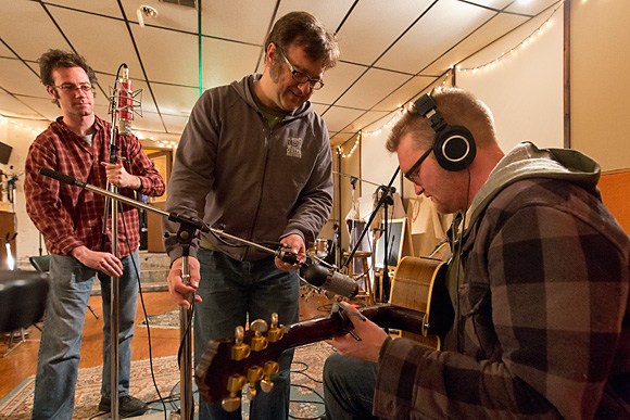 Greg McIntosh and Jim Roll set up mics to record Matt Jones at Backseat Productions