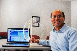Dilip Nigam of Arborwind with a model of his wind turbine