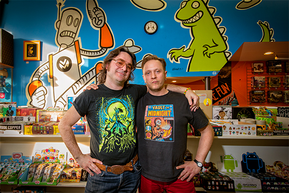 Jeremy Wheeler and the Vault of Midnight's Curtis Sullivan in front of Jeremy's wall mural