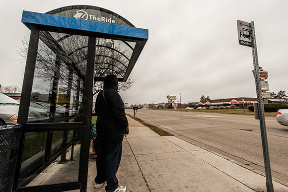 Waiting for the AATA bus on Washtenaw Avenue in Ypsilanti