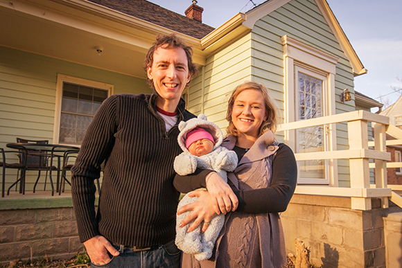 Author Natalie Burg with husband Mike Vial and baby Ginny at their Superior Township home