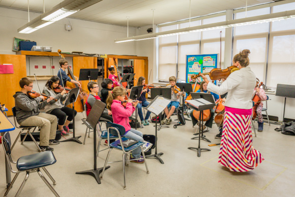 Orchestra teacher Kristi Luckritz with her students at Ann Arbor STEAM