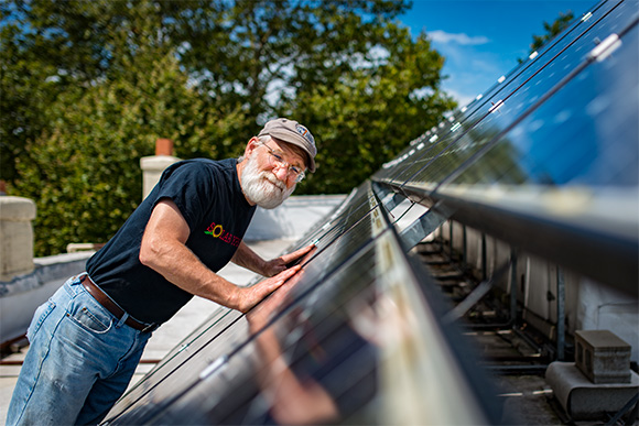 Dave Strenski with the solar panels at the Ypsilanti Food Coop