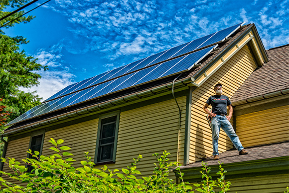 Dave Strenski with the solar panels on the roof of his house