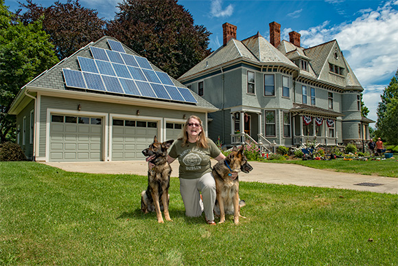 Maggie Brandt's historic Ypsilanti home with solar panels on the garage
