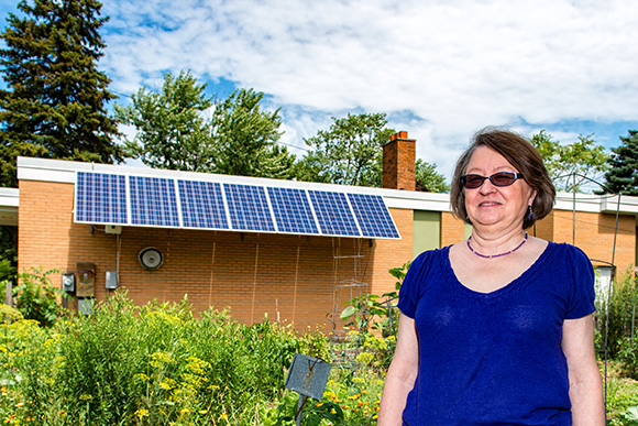 Director Monica Prince with the solar panels on the Ypsilanti Senior Center
