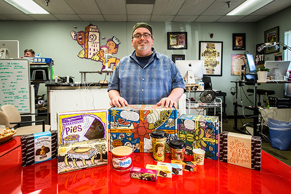 Ian Nagy with many examples of his work for Zingerman's