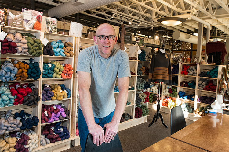 Spun Ann Arbor co-owner and cartoonist Pete Sickman-Garner at the new Kerrytown shop