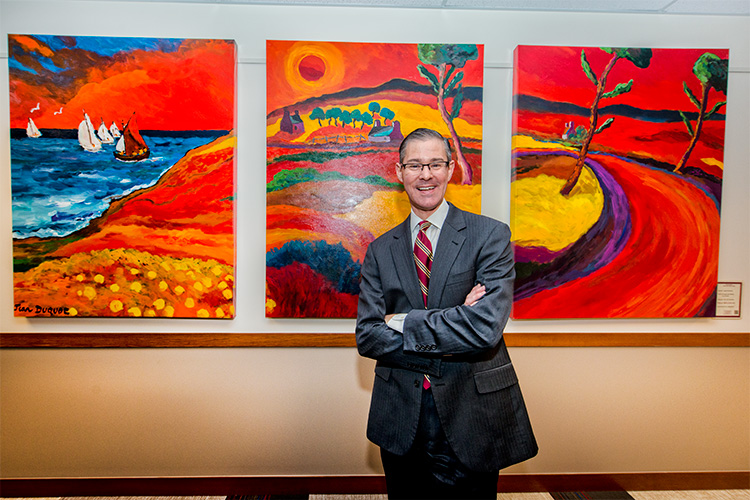 John Petz with some of the extensive collection of the Ave Maria Fine Art Gallery at Domino's Farms