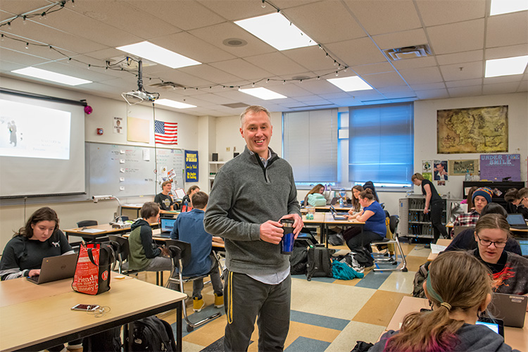 Saline High School teacher Jamie Volrath with one of his zine classes