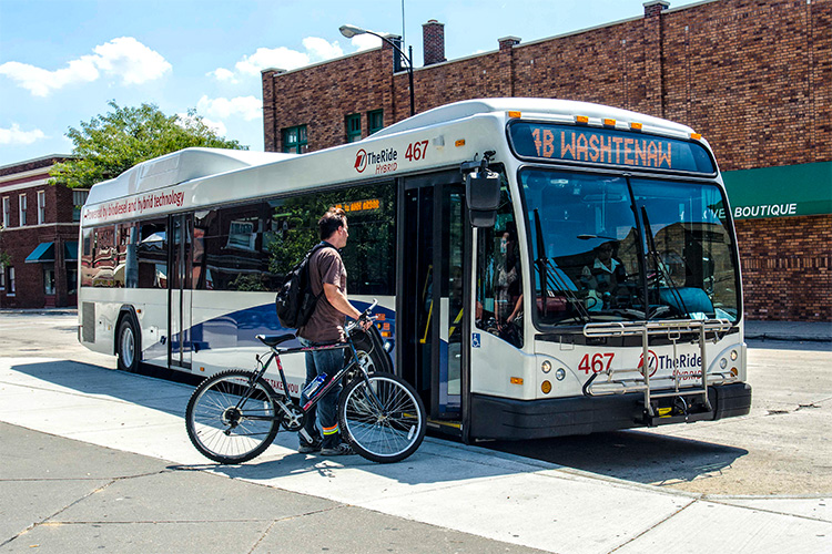 Loading a bike on a bus at the Ypsilanti Transit Center