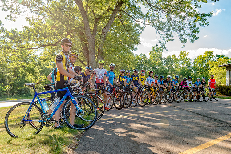 Cyclists turn around on Huron River Drive in Dextre