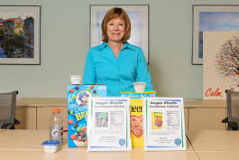 Jean DuRussell-Weston with a display of sugar amounts in popular foods