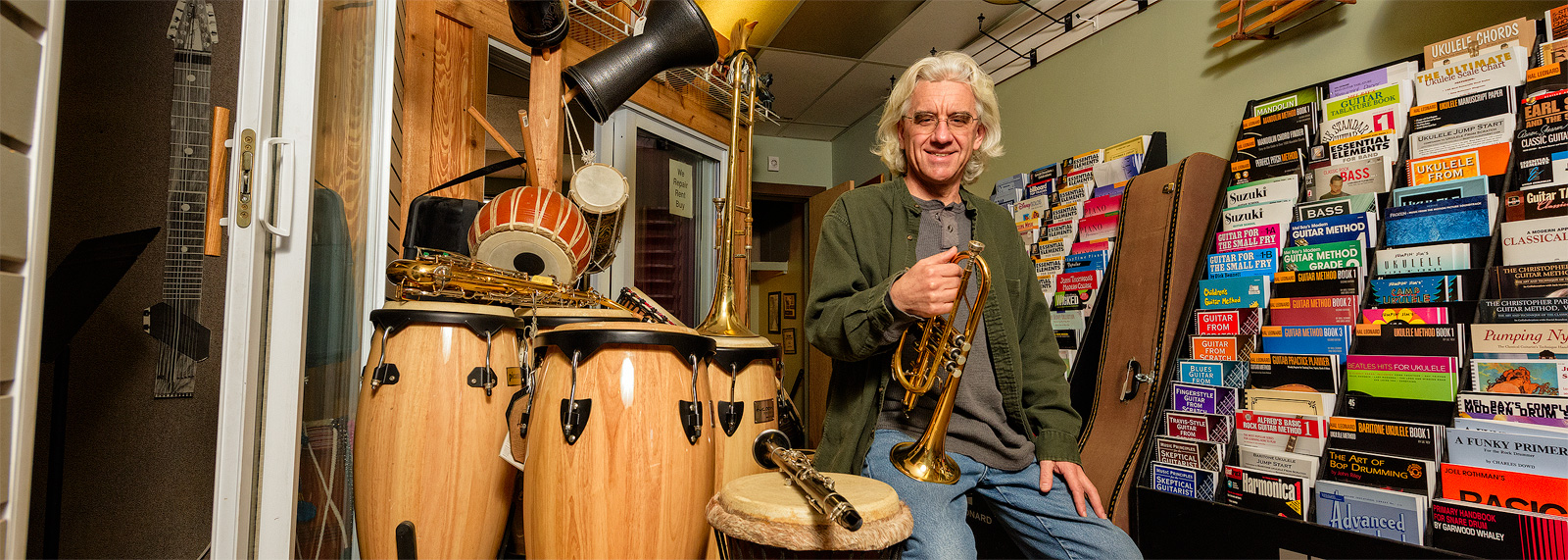 Ken Kozora of Horns for the Holidays at Oz's Music <span class='image-credits'>Doug Coombe</span>