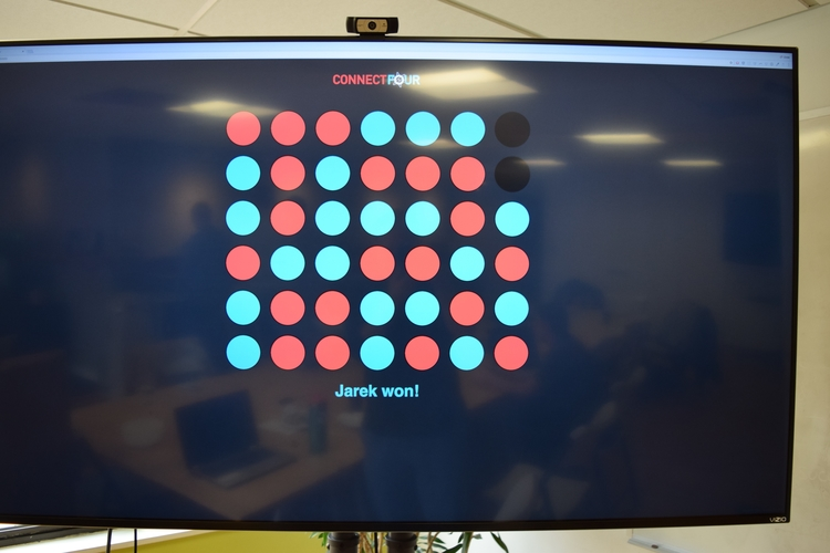 A display shows a game of Connect Four at the Atomic Games.