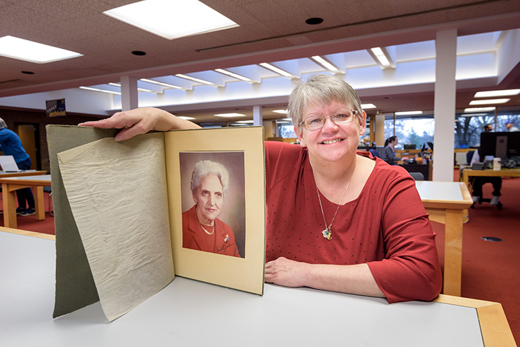 Deb Anderson with a photo of her grandmother and Youth For Understanding Founder Rachel Andresen