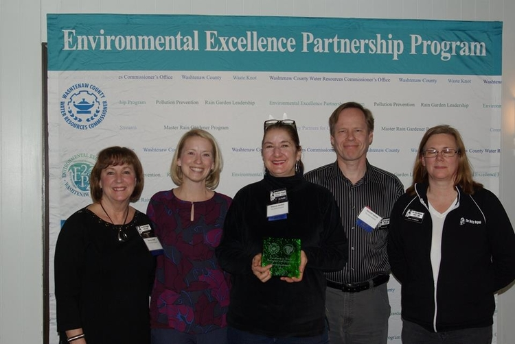 The Betty Brigade collects its award for waste reduction and recycling.