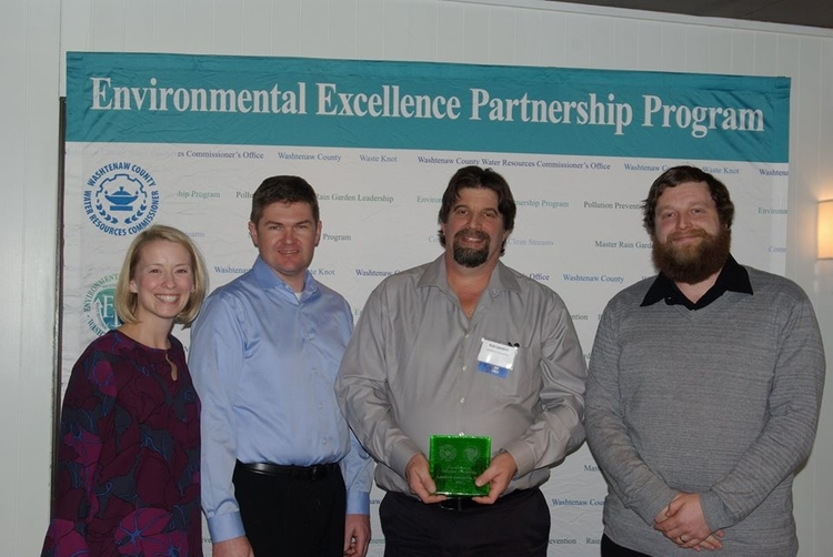 Lambert Industries collects its award for pollution prevention.