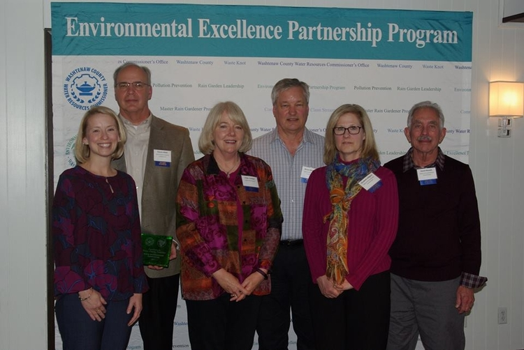 The Saline Environmental Commission collects its award for water quality protection.