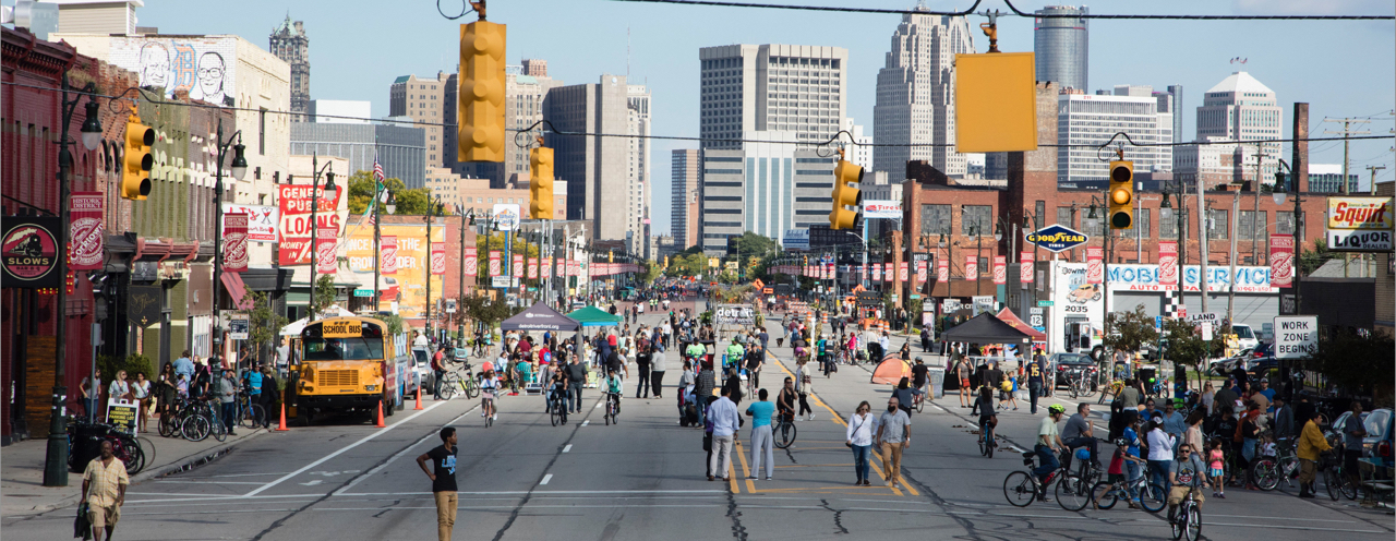 People roam Michigan Avenue during the Open Streets Detroit event.